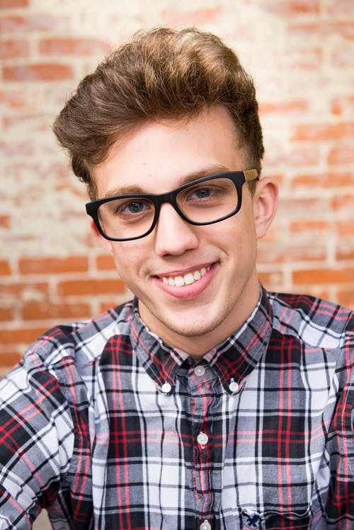 Man Wearing Eyeglasses And Smiling