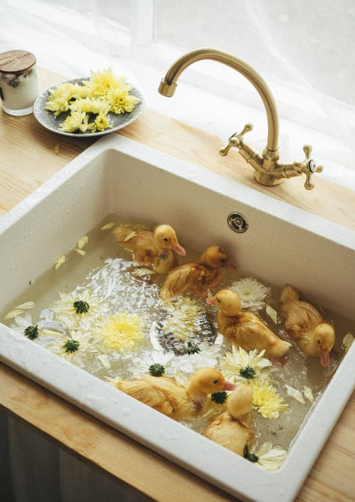 White Ceramic Bathtub With Gold and White Flowers