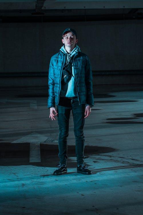 Boy Wearing Black Zip-up Bubble Jacket