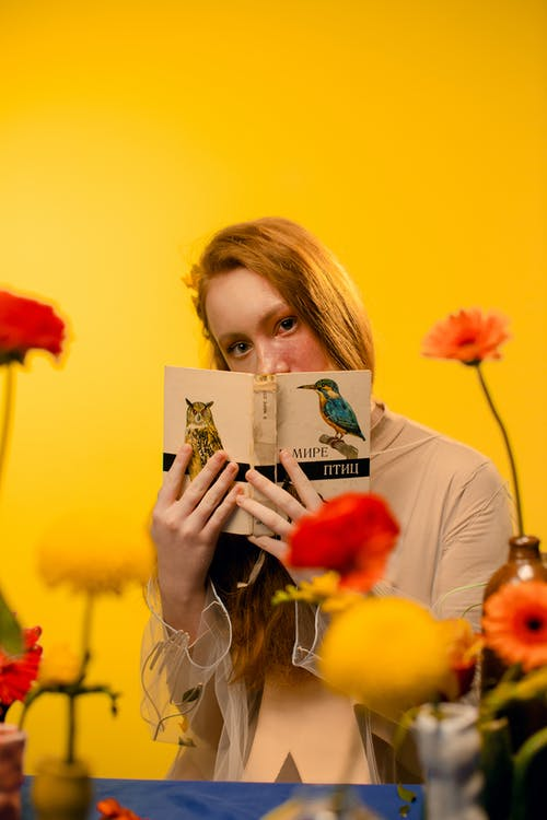 Girl in Red Shirt Holding Book
