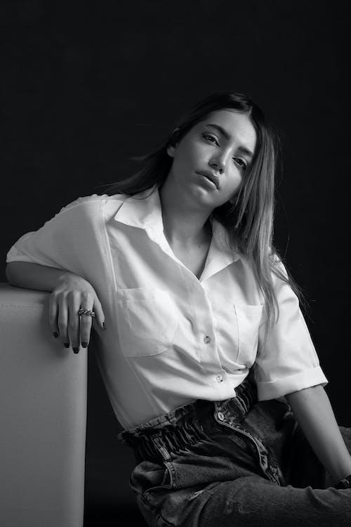Trendy model in blouse on black background