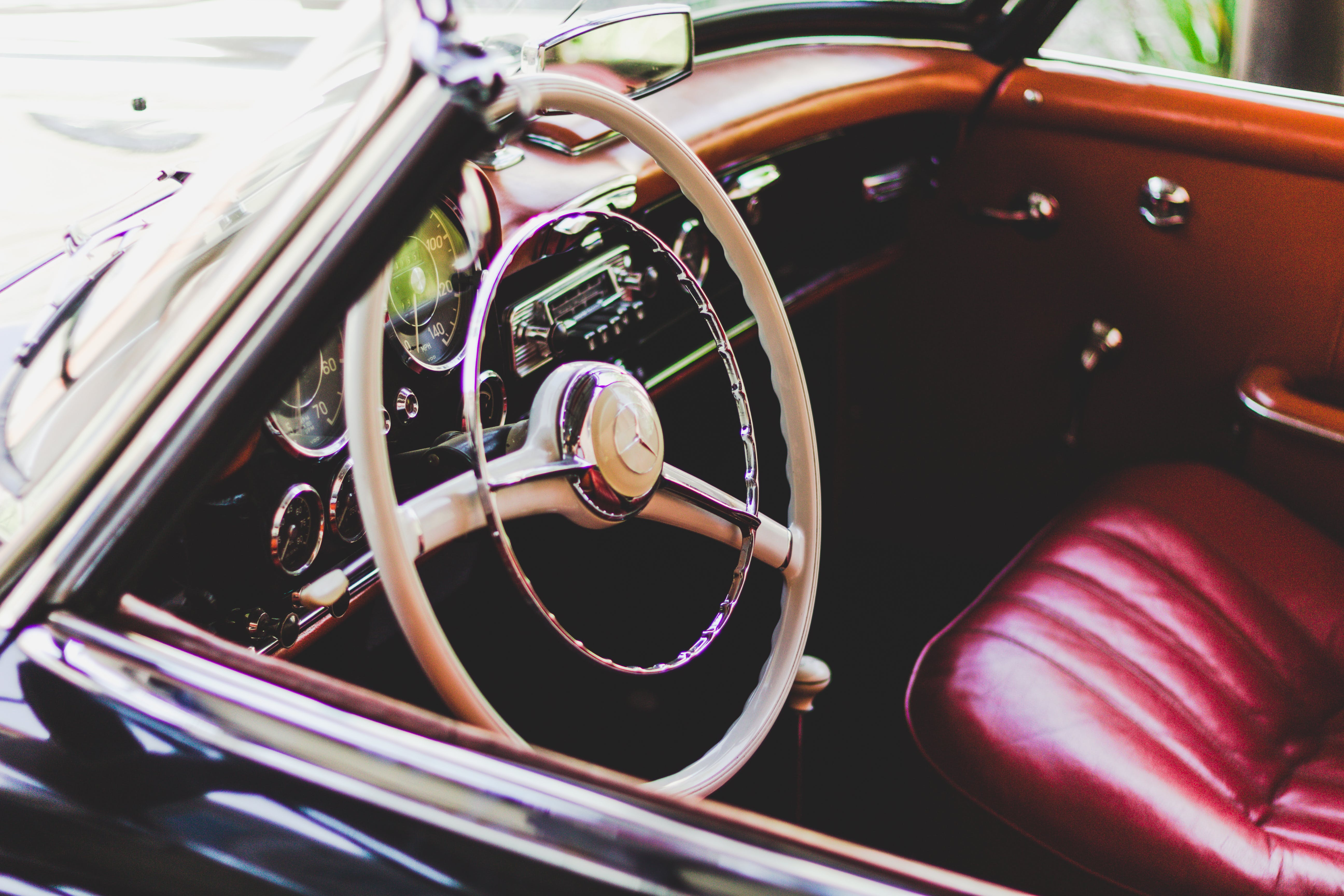 Photography of Red Leather Vehicle Interior