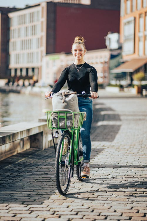 A Woman Riding a Bicycle