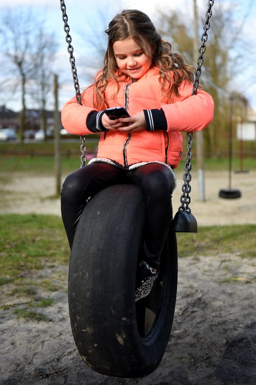 Free stock photo of mobile phone, playing, swing