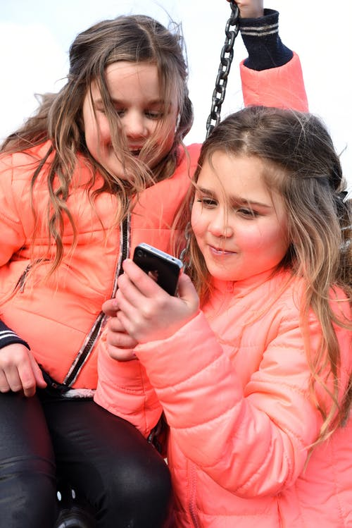 Free stock photo of girls, mobile phone, playing