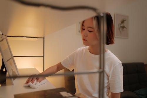 Woman in White Crew Neck T-shirt Holding White Printer Paper