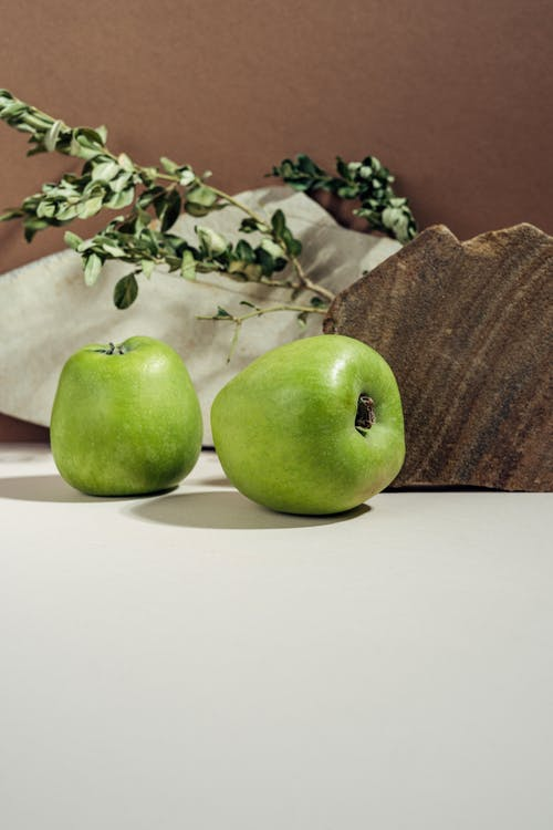 Green Apples on White Surface