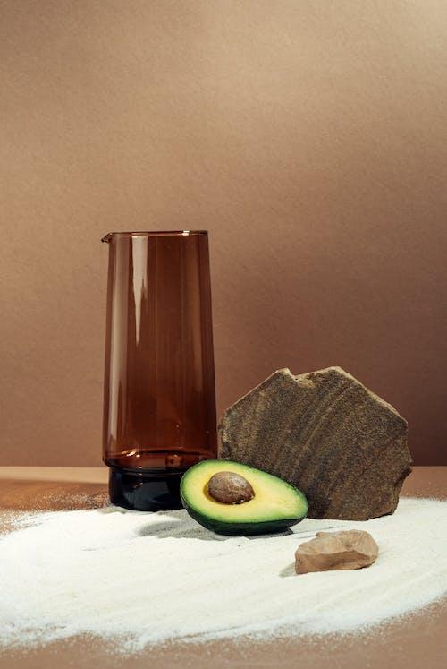 Sliced Avocado Near Brown Long Glass