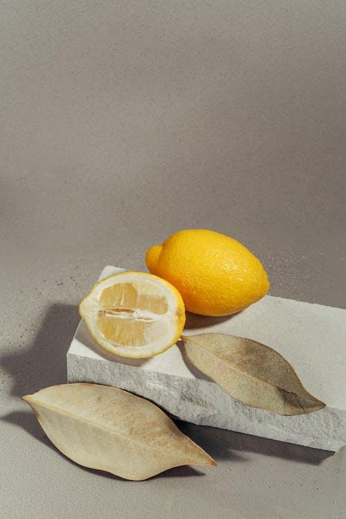 Foto profissional grátis de amarelo, cítrico, estúdio