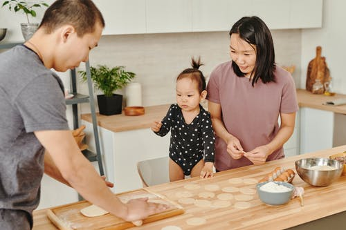 Asian Family Preparing Food Together