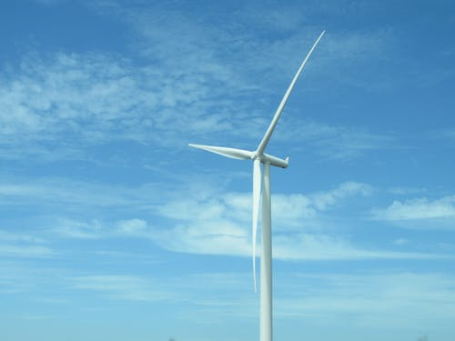 Close Up Photo of White Windmill