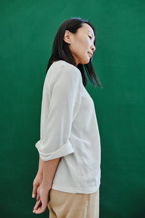 Woman in White Long Sleeve Shirt and Brown Shorts