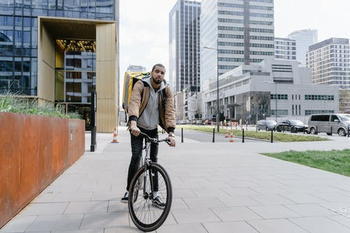 Deliveryman Riding a Bicycle