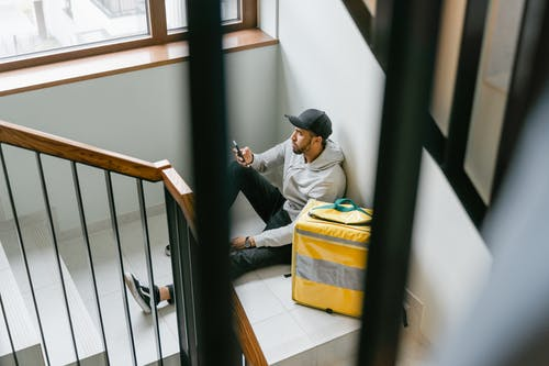 Man Sitting on the Staircase Waiting