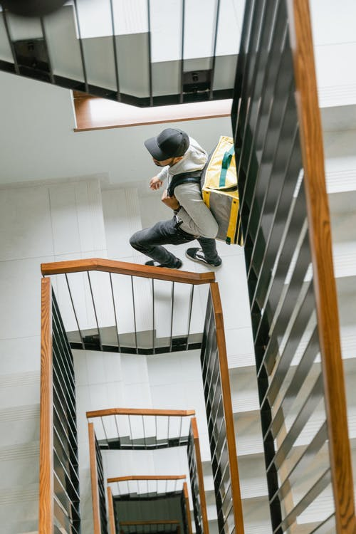 Deliveryman Going Up the Stairs