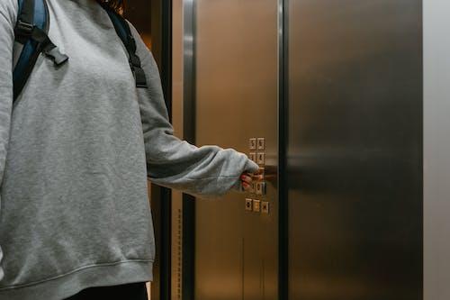 Person Pressing the Elevator Button
