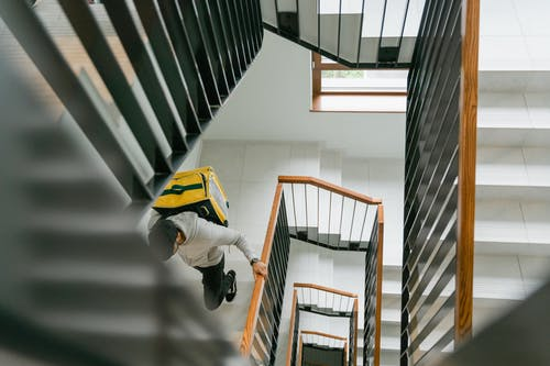 Man Going Up the Stairs