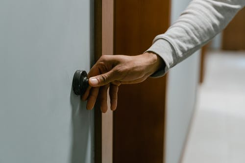 Person Ringing the Doorbell
