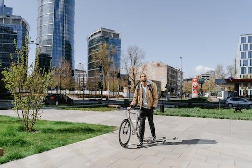 Man in Brown Jacket and Black Pants Walking