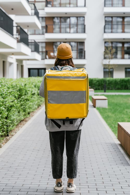 Deliveryman Carrying a Yellow Bag