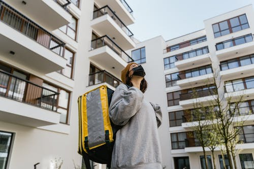 Woman in Gray Sweater Carrying a Yellow Bag