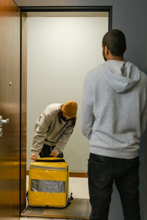Deliveryman Standing at the Door