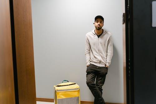 Deliveryman Waiting at the Door