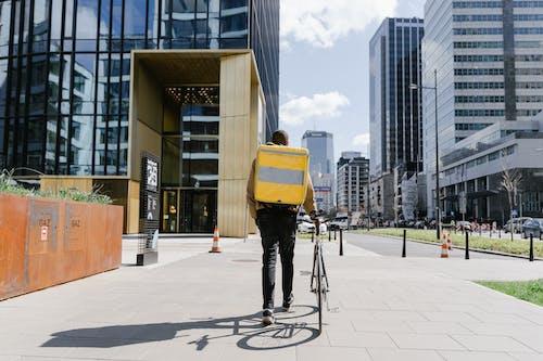 Man Carrying a Bag Walking