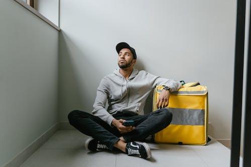 Man Sitting on the Floor Waiting