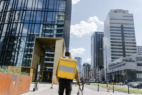 Man Carrying a Delivery Bag