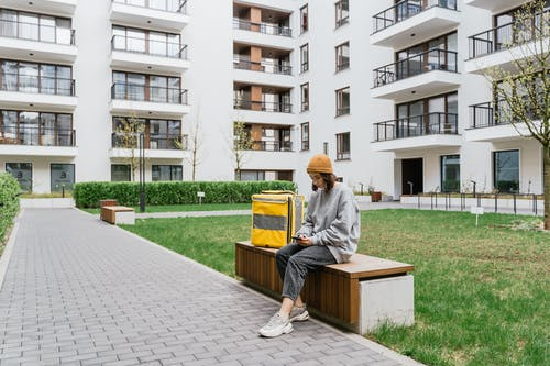 Woman Sitting on a Bench Waiting