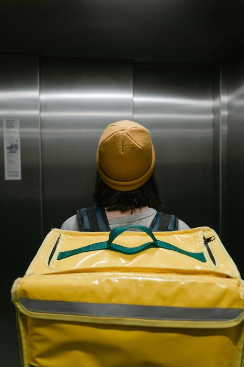 Deliveryman Inside an Elevator