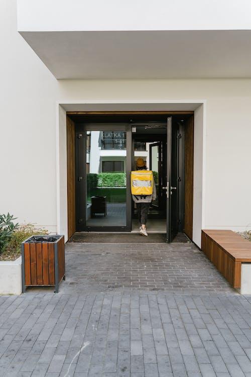 Deliveryman Going Inside a Building