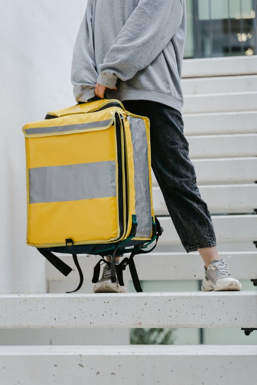 Person Carrying a Yellow Bag