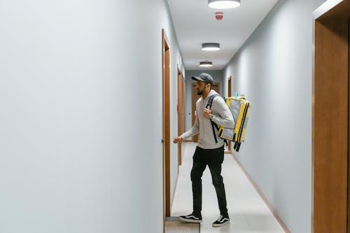 Man Walking Towards a Door
