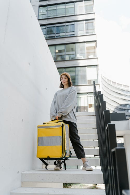 Woman Carrying a Yellow Bag