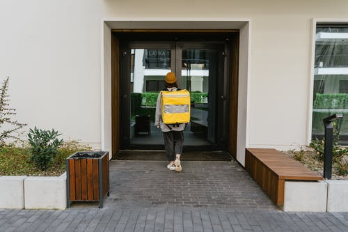 Person Walking Towards a Door