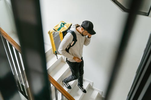 Man Going Down the Stairs