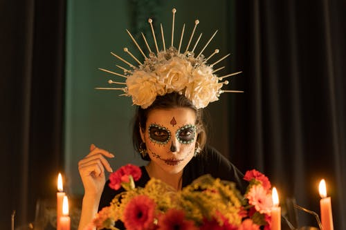 Woman in Skeleton Make Up with Floral Crown Headdress