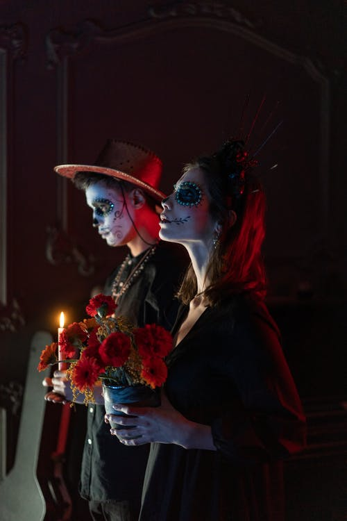 Man and Woman in Halloween Skeleton Make Up