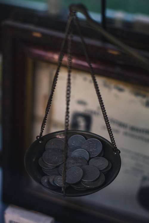 A Balance Scale with Coins