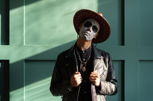 A Man with Face Paint Wearing a Hat