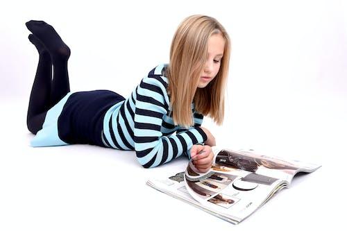 Free stock photo of girl, magazine, reading
