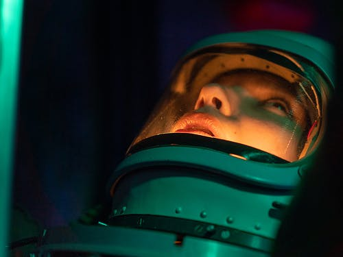 Person in Green and Black Space Suit