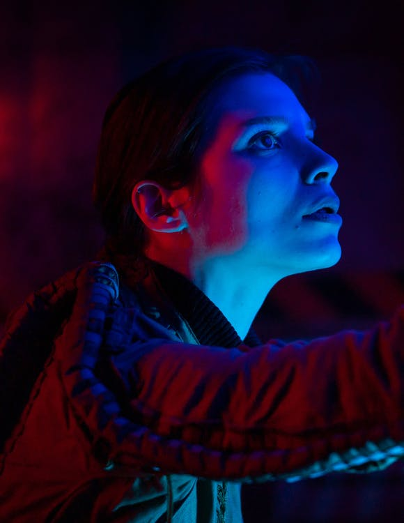 Photo Of Woman With Reflection of Blue Light On Face