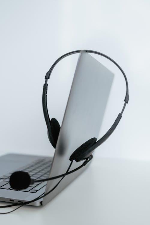 Black and Gray Headset on White Table