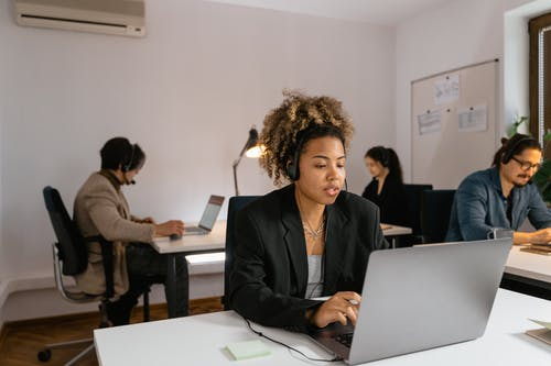 People Working in an Office with their Laptops