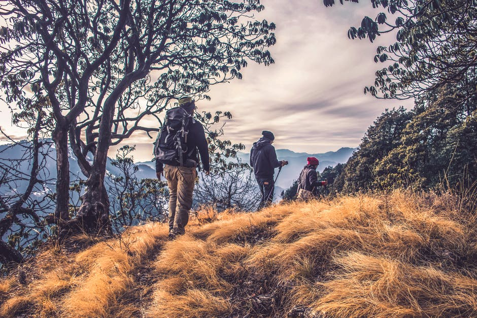 Three People Hiking on High Mountain · Free Stock Photo