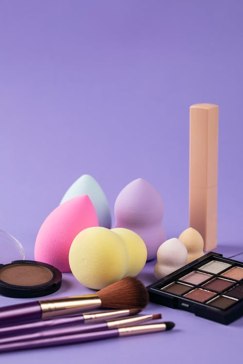 Makeup Products on Purple Surface