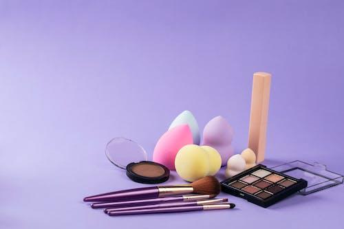 Makeup Tools on Purple Surface